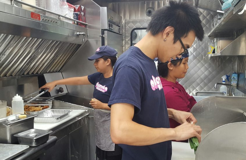 Employees prepping the food truck