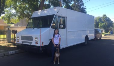 A mysterious white, new truck with our chef Chizuru and Honey standing in front of it.
