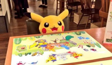 Interior of Pokemon Cafe with a stuffed Pikachu seated at the table